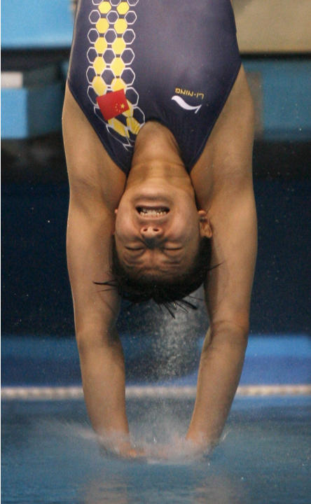 China's He Zi breaks into the water to win the gold medal in the women's 1-metre springboard competition at the World Aquatic Championships in Melbourne