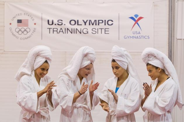 USA Gymnastics national team members, from left, Mattie Larson of Los Angeles, Calif., Bridget Sloan, of  Pittsboro, Ind.,  Alexandra Raisman of Needham, Mass. and Alicia Sacramone of Winchester, Mass
