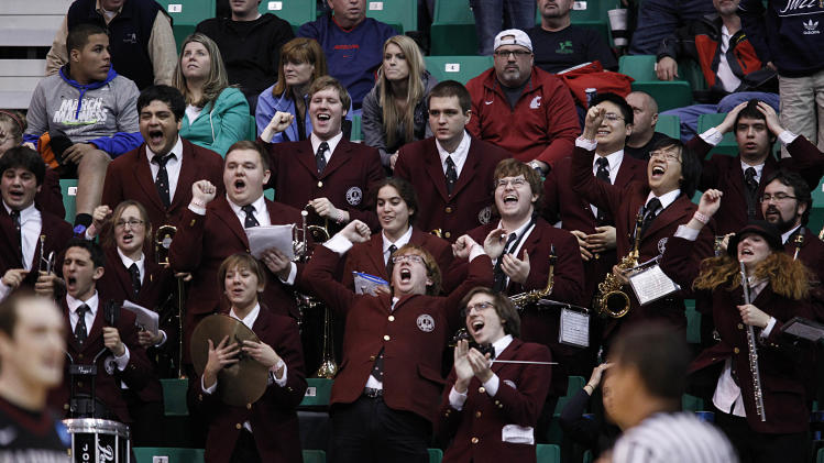 The Harvard band reacts to beating New Mexico in the second half during a second round game in the NCAA college basketball tournament in Salt Lake City Thursday, March 21, 2013. Harvard beat New Mexico 68-62. (AP Photo/George Frey)