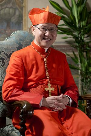 FILE - This Nov. 24, 2012 file photo shows the then newly-elected Cardinal Luis Antonio Tagle, Archbishop of Manila, Philippines, posing for photographers prior to meeting relatives and friends after he was elevated to cardinal by Pope Benedict XVI, at the Vatican. Philippine Cardinal Luis Antonio Tagle's best response against the tide of secularism, clergy sex abuse scandals and rival-faith competition could be his reputation for humility. His compassion for the poor and unassuming ways have impressed followers in his homeland, Asia's largest Catholic nation, and church leaders in the Vatican. (AP Photo/Andrew Medichini, File)