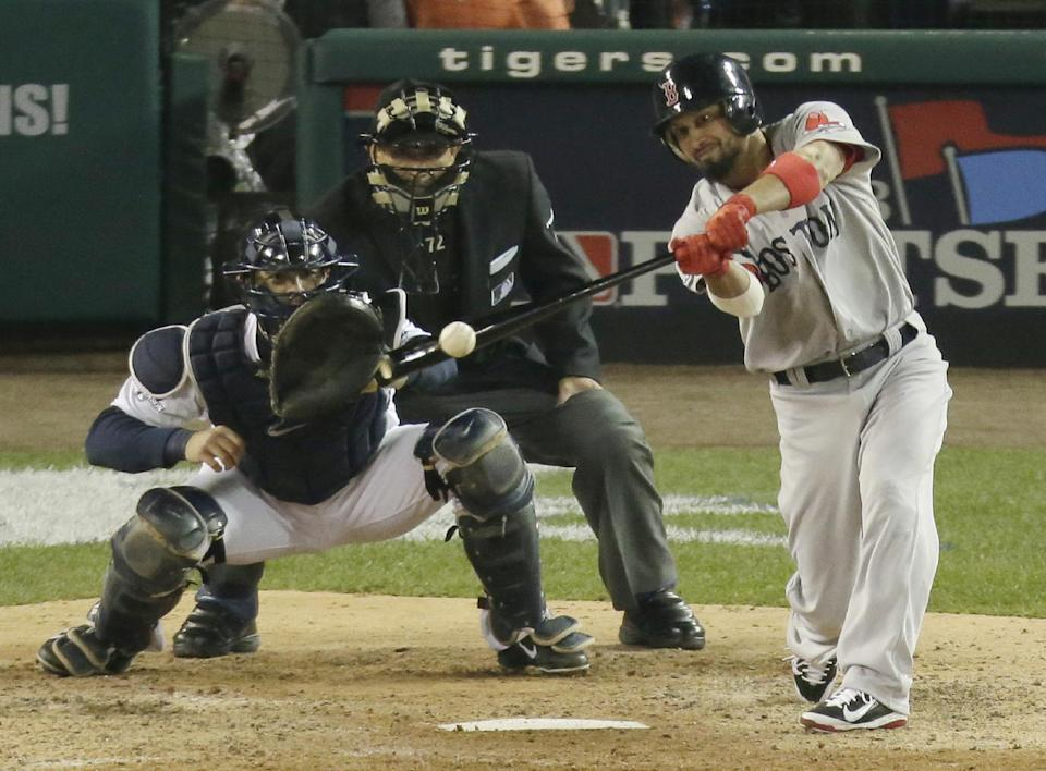 Boston Red Sox's Shane Victorino hits an RBI double in the seventh inning during Game 4 of the American League baseball championship series against the Detroit Tigers, Wednesday, Oct. 16, 2013, in Detroit. (AP Photo/Charlie Riedel)