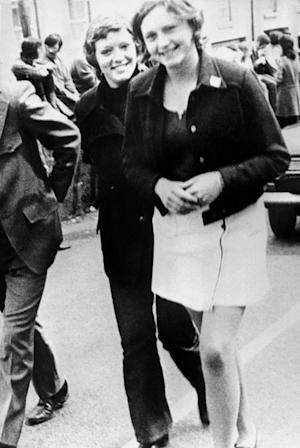 FILE - In this file photo dated June 4, 1972 Dolours Price, left, and her sister Marian attend a civil rights demonstration in Belfast, Northern Ireland. Police say Thursday Jan. 24, 2013, Dolours Price, a veteran Irish Republican Army member at the center of allegations against Sinn Fein leader Gerry Adams has been found dead at her home. Dolours Price had alleged that Adams was her IRA commander in Belfast in the early 1970s and was involved in ordering several Catholic civilians to be abducted, executed and buried in secret. (AP Photo, File)