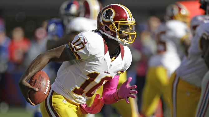Washington Redskins quarterback Robert Griffin III (10) rushes during the first half of an NFL football game against the New York Giants Sunday, Oct. 21, 2012 in East Rutherford, N.J. (AP Photo/Kathy Willens)