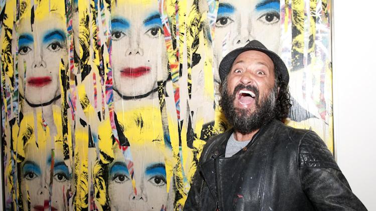 French artist Mr. Brainwash, real name Thierry Guetta poses in front of his artwork 'Michael Jackson', before the opening of his exhibition in London, Wednesday, Oct. 5, 2011. Thierry Guetta is a Los Angeles based urban street artist. (AP Photo/Marta Ovod)