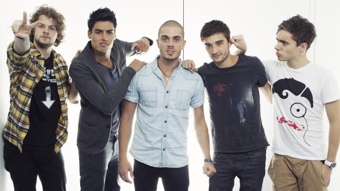 """This Aug. 22, 2012 photo shows members of the British boy band """"The Wanted"""", from left, Jay McGuiness, Siva Kaneswaran, Max George, Tom Parkerand Nathan Sykes posing for a portrait at JetBlue's T5 at JFK International Airport in New York. The Wanted, who had a hit this year with the party jam """"Glad You Came,"""" are up against fellow brish band One Direction, Canadian sensation Carly Rae Jepsen, R&B singer Frank Ocean and pop-rockers fun. for best new artist at the MTV Video Music Awards on Sept. 6.  (Photo by Victoria Will/Invision/AP)"""