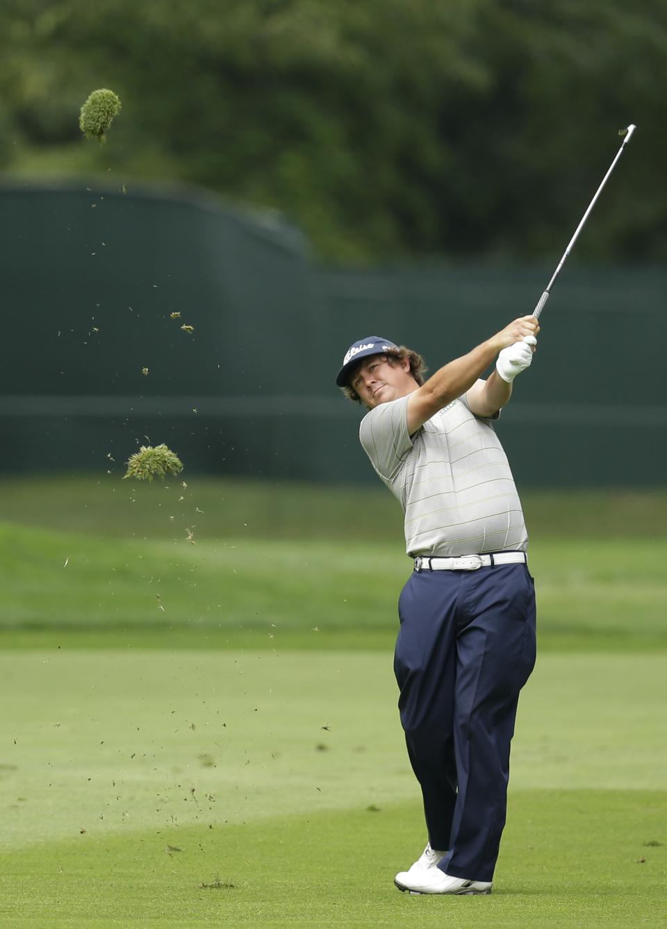 Jason Dufner hits from the fairway on the eighth hole during the second round of the PGA Championship golf tournament at Oak Hill Country Club, Friday, Aug. 9, 2013, in Pittsford, N.Y. (AP Photo/Charlie Neibergall)
