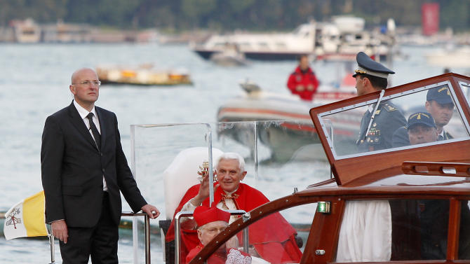 Pope Benedict XVI waves from a motorboat upon his arrival in Venice, Italy, Saturday, May 7, 2011. Pope Benedict XVI arrives in Venice Saturday for a two-day pastoral visit, the first by a pope since his predecessor John Paul II plied the canals 26 years ago in a gondola built for Venice's Byzantine-era rulers. The 27-hour visit began with a stop in a nearby town, Aquileia, where Benedict was greeted by hundreds of flag-waving faithful. The visit, taking place under tight security, includes a visit to a medieval basilica, an appearance at St. Mark's Square, an open-air Mass on the Venetian mainland and a gondola ride to the Basilica of Our Lady of Good Health. (AP Photo/Antonio Calanni)