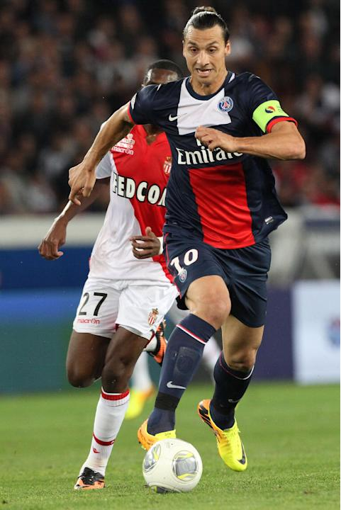 Paris Saint Germain's forward Zlatan Ibrahimovic from Sweden, right,  runs with the ball ahead of Monaco's Geoffrey Kondogbia, during their French League One soccer match, at the Parc des Princes stad