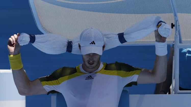 Britain's Andy Murray applies a ice-towel as he attempts to keep cool during his first round match against Robin Haase of the Netherlands at the Australian Open tennis championship in Melbourne, Australia, Tuesday, Jan. 15, 2013. (AP Photo/Andy Wong)