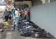 Body bags containing bodies of the victims are laid on a pavement after a fire gutted a department store in Butuan City, Agusan del Norte province, southern island of Mindanao, on May 9. Seventeen shop staff sleeping in the department store were killed when a fire swept through the building before dawn