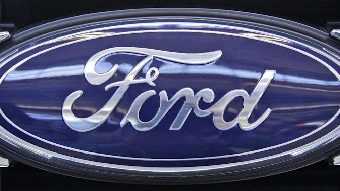 This Feb.16, 2012 photo shows the Ford logo at the 2012 Pittsburgh Auto Show. U.S. safety regulators are investigating complaints that the accelerators can stick in Ford Tauruses from the 2005 and 2006 model years. (AP Photo/Gene J. Puskar)