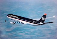 File picture shows a US Airways jet flying over Toulouse, southern France. A US Airways flight from Paris to Charlotte, North Carolina was diverted, May 22, to an airport in Maine after a French woman claimed she had a &quot;surgically implanted device.&quot;