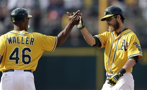 A's edge White Sox on bases-loaded walk in 10th
