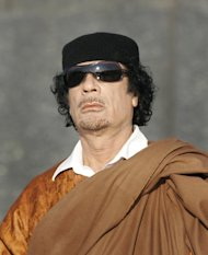 FILE - In this Monday, Nov. 3, 2008 file photo, Libya's leader Moammar Gadhafi attends a wreath laying ceremony in the Belarus capital Minsk. The Associated Press is aware of reports that Moammar Gadhafi has been captured in Sirte. The chief spokesman for the revolutionary National Transitional Council Jalal el-Gallal and the council military spokesman Abdul-Rahman Busin tell the AP that those reports are unconfirmed.(AP Photo/Sergei Grits, File)