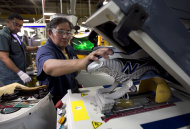 <p>               FILE - In this Tuesday, May 1, 2012, file photo, worker Maria Contrero, of Boston, removes an elite running shoe from a sole press during the assembly process at the New Balance Athletic Shoe, Inc. factory in Boston. A U.S. economy that plodded along in the first three months of the year likely grew even less in the April-June quarter. And most economists no longer think growth will strengthen much in the second half of 2012.  (AP Photo/Steven Senne, File)