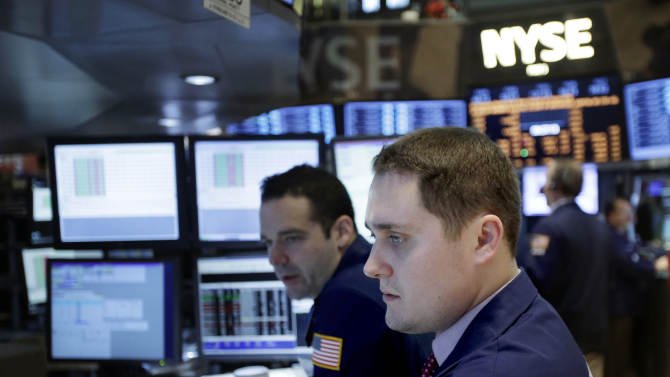 In this Friday, Dec. 28, 2012, photo, traders work on the floor at the New York Stock Exchange in New York. World stock markets headed lower Tuesday Jan. 8, 2013 as investors turned cautious before U.S. earnings season kicks off this week. (AP Photo/Seth Wenig)