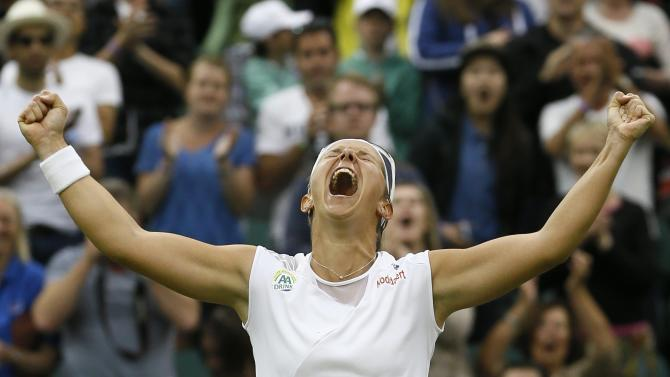 Kirsten Flipkens of Belgium reacts after defeating Petra Kvitova of the Czech Republic in the Women's singles quarterfinal match at the All England Lawn Tennis Championships in Wimbledon, London, Tuesday, July 2, 2013. (AP Photo/Kirsty Wigglesworth)