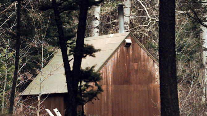"FILE - In this April 6, 1996 file photo, Unabomber Theodore Kaczynski's cabin is shown in the woods of Lincoln, Mont. The 1.4-acre parcel of land in western Montana that was once owned by Kaczynski is on the market for $69,500. The listing offers potential buyers a chance to own a piece of ""infamous U.S. history"" and says the forested land ""is obviously very secluded. (AP Photo/Elaine Thompson, File)"
