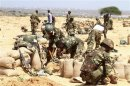 African Union prepare sand bags during fighting against al Shabaab militants in the district of Daynile