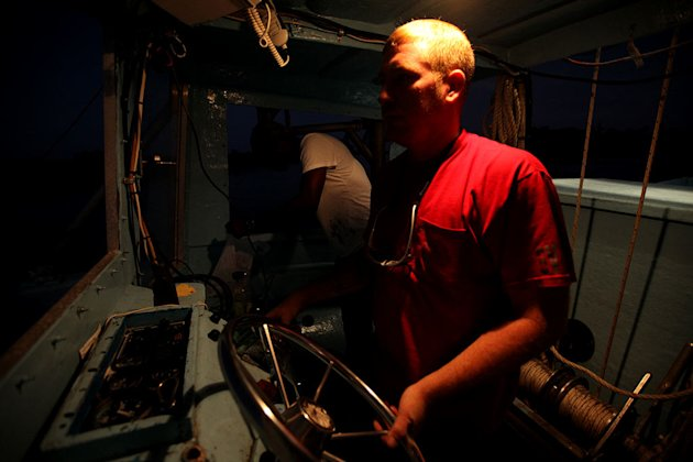 "Captain Trae takes the wheel in the night as seen on ""Ragin' Cajuns."""