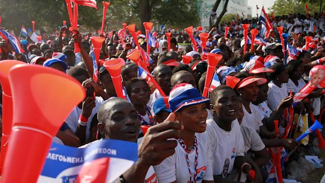 Supporters of opposition presidential candidate Nana Akufo-Addo cheer during his final campaign rally ahead of Friday's presidential election, in Accra, Ghana, Wednesday, Dec. 5, 2012. After five coups and decades of stagnation, the West African nation of 25 million is now a pacesetter for the continent's efforts to become democratic. Ghanaians will go to the polls on Friday to choose between four candidates, including President John Dramani Mahama, a former vice president who assumed the top post in July after the death of president John Atta Mills, and former foreign minister Akufo-Addo who lost the presidency by less than 1 percent in 2008. (AP Photo/Christian Thompson)
