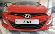 "Hyundai Motor's hatchback ""i30"" on display in a showroom in Seoul. South Korea's largest carmaker says its second-quarter net profit rose 10.4% from a year earlier thanks to strong overseas sales"