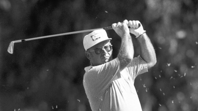 FILE - In this Feb. 21, 1981 file photo, Miller Barber takes on iron off the 13th fairway during the second round of the Glen Campbell Open golf tournament at the Riviera Country Club in Los Angeles. Barber, the unique-swinging golfer who made the most combined starts on the PGA and Champions tours, died Tuesday, June 11, 2013, the PGA said on Wednesday. He was 82. (AP Photo/Reed Saxon, File)