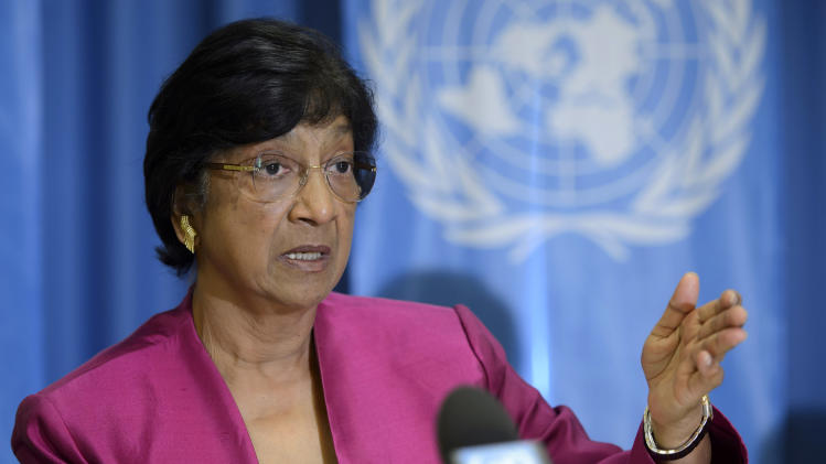 UN High Commissioner for Human Rights, South African Navi Pillay, answers journalist's questions about the human rights situation in the world, during a press conference at the Geneva Press Club, in Geneva, Switzerland, Thursday, July 31, 2014. (AP Photo/Keystone, Martial Trezzini)