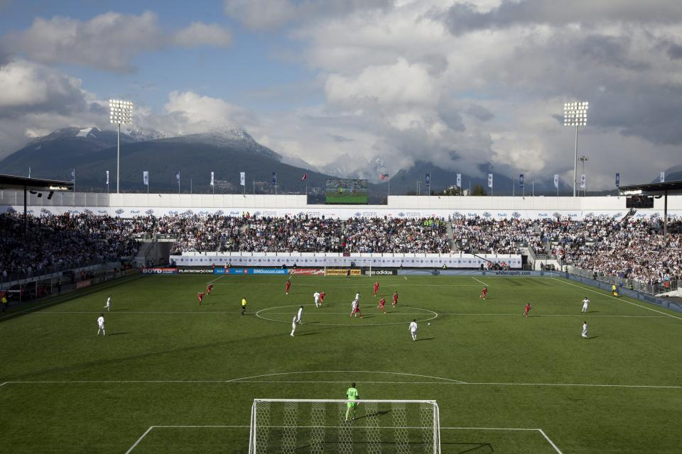 The Northshore mountains are seen in the background as a sold out crowd watches the Vancouver Whitecaps FC inaugural game against the Toronto FC during the first half of an MLS soccer game in Vancouver, B.C., on Saturday March 19, 2011.  (AP Photo/The Canadian Press, Jonathan Hayward)