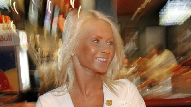 "In this May 16, 2012 photo, Rose Dimov serves lunch at the Tilted Kilt, in Tempe, Ariz. The Tilted Kilt is part of a booming niche in the beleaguered restaurant industry known as ""breastaurants,"" or sports bars that feature scantily-clad waitresses. These small chains operate in the tradition of Hooters, which pioneered the concept in the 1980s but has struggled in recent years to stay fresh. (AP Photo/Matt York)"