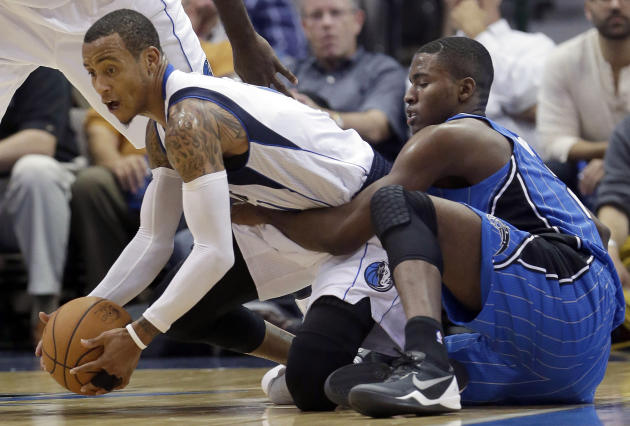 Orlando Magic small forward Maurice Harkless (21) grabs Dallas Mavericks point guard Monta Ellis (11) as they grapple for the loose ball during the second half of an NBA preseason basketball game in D