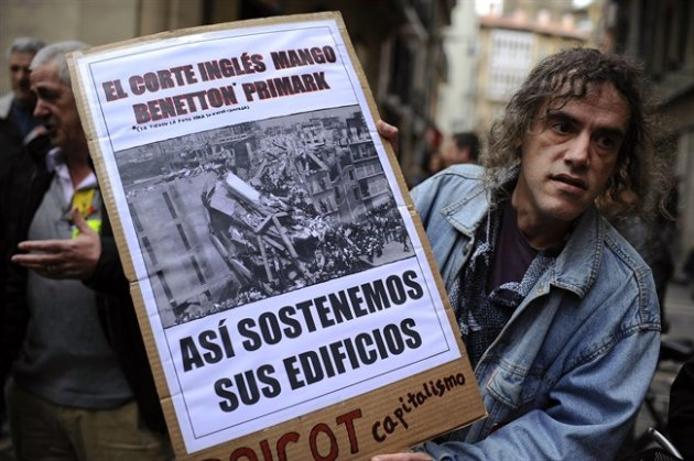 A man protests against textile multinationals in Pamplona, Spain on May 1, 2013. THE CANADIAN PRESS/AP, Alvaro Barrientos