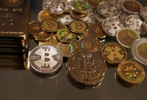 File photo shows bitcoins created by Mike Caldwell in this photo illustration at his office in Sandy, Utah