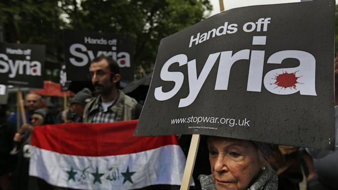 Protesters demonstrate against western intervention in Syria, outside the US embassy in central London, Saturday, June 15, 2013. (AP Photo/Lefteris Pitarakis)