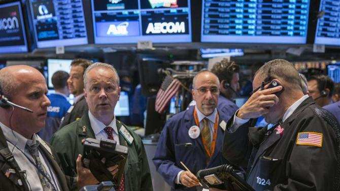 Traders work on the floor of the New York Stock Exchange shortly after the opening bell in the Manhattan borough of New York