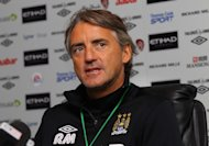 Roberto Mancini stressed Manchester City's main priority is retaining the league title