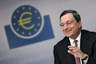 "<p>The leaders of Germany and France have thrown their political support behind ECB chief Mario Draghi, seen here on July 5, and his pledge to do ""everything"" to protect the eurozone, after another brutal week of market turmoil.</p>"