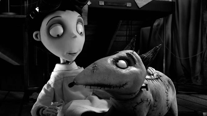 """This film image released by Disney shows Victor Frankenstein, voiced by Charlie Tahan, with Sparky, in a scene from """"Frankenweenie.""""  The film was nominated for a Golden Globe for best animated film on Thursday, Dec. 13, 2012. The 70th annual Golden Globe Awards will be held on Jan. 13. (AP Photo/Disney)"""