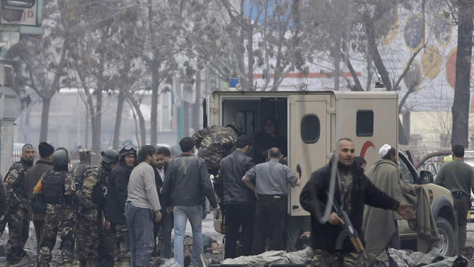 Afghans load victims into an ambulance at the scene of a suicide car bomb attack in Kabul, Afghanistan, Wednesday, Jan. 16, 2013. Six militants — one driving a car packed with explosives — attacked the gate of the Afghan intelligence service in the capital Kabul on Wednesday, setting off a blast that could be heard throughout downtown and which sent a plume of dark smoke rising into the sky. (AP Photo/Musadeq Sadeq)