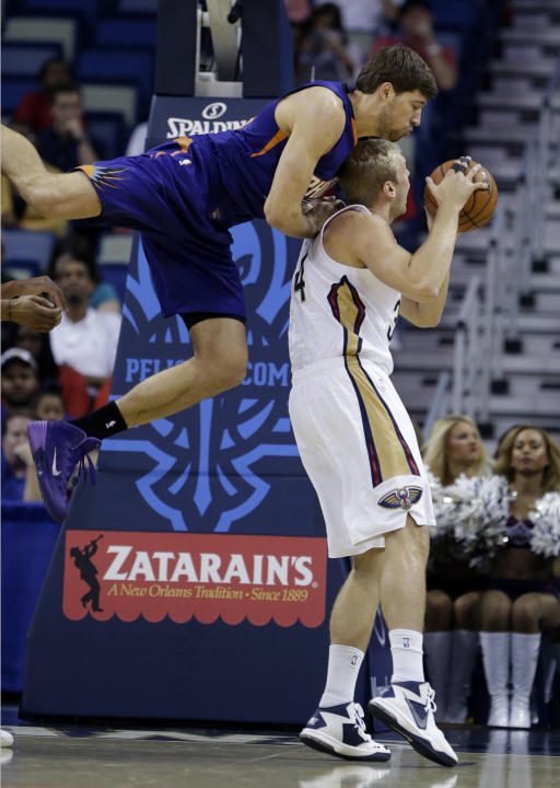 Phoenix Suns center Slava Kravtsov goes over the back of New Orleans Pelicans center Greg Stiemsma in the first half of an NBA basketball game in New Orleans, Tuesday, Nov. 5, 2013