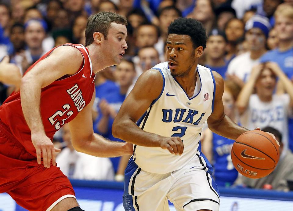 Duke's Quinn Cook, right, looks around Davidson's Tom Droney during the first half of an NCAA college basketball game in Durham, N.C., Friday, Nov. 8, 2013. (AP Photo/Karl B DeBlaker)
