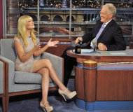 FILE - In this May 7, 2012 file photo provided by CBS, Beth Behrs, co-star of &quot;Two Broke Girls&quot; talks with host David Letterman on the set of the &quot;Late Show with David Letterman,&quot; in New York. Hurricane Sandy didn&#39;t just halt airline flights and the stock market on Monday, Oct. 29, 2012, it also caused widespread cancellations across the entertainment industry. David Letterman and Jimmy Fallon are doing their shows without an audience because of the storm. (AP Photo/CBS, John Paul File) MANDATORY CREDIT; NO ARCHIVE; NO SALES; NORTH AMERICAN USE ONLY
