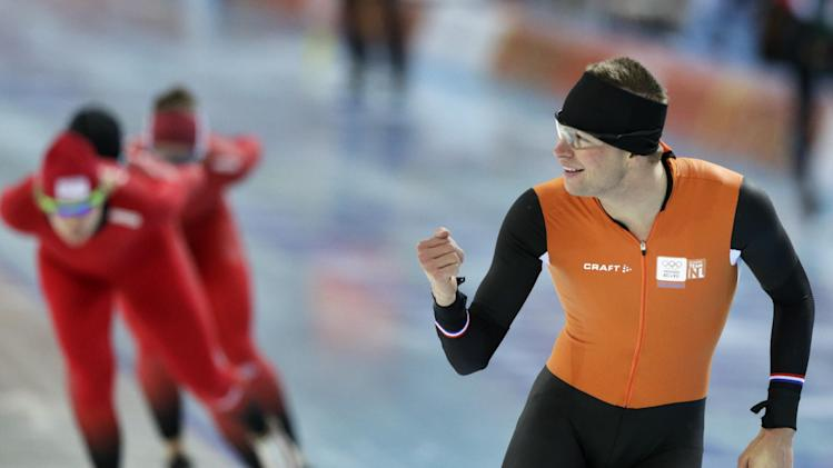 Speedskater Sven Kramer of the Netherlands gestures to a teammate as he trains at the Adler Arena Skating Center during the 2014 Winter Olympics in Sochi, Russia, Wednesday, Feb. 5, 2014. (AP Photo/Matt Dunham)