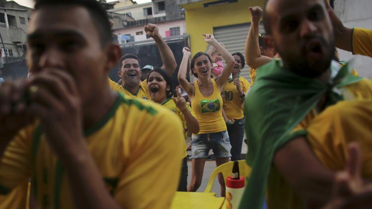 Brazilian soccer fans celebrate their team's goal against Cameroon in Sao Paulo