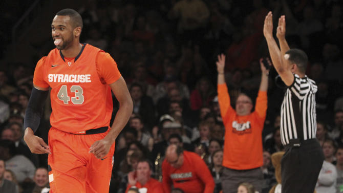 Syracuse's James Southerland reacts after scoring during the first half of an NCAA college basketball game against Pittsburgh at the Big East Conference tournament, Thursday, March 14, 2013 in New York. (AP Photo/Mary Altaffer)