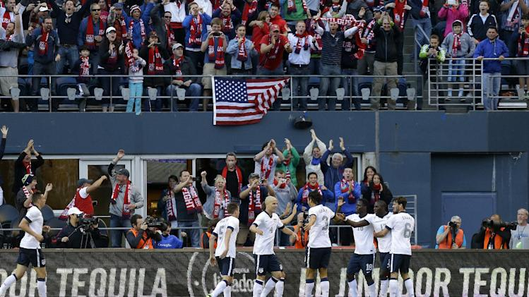 United States' Jozy Altidore, second from right, celebrates with Brad Evans, right, and Eddie Johnson, third from right, and other teammates after Altidore scored a goal against Panama in the first half of a World Cup qualifier soccer match, Tuesday, June 11, 2013, in Seattle. (AP Photo/Ted S. Warren)