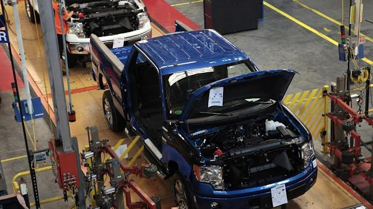 A 2014 Ford F-150 pick-up truck moves down the assembly line at the Ford Motor Dearborn Truck Plant in Dearborn, Michigan
