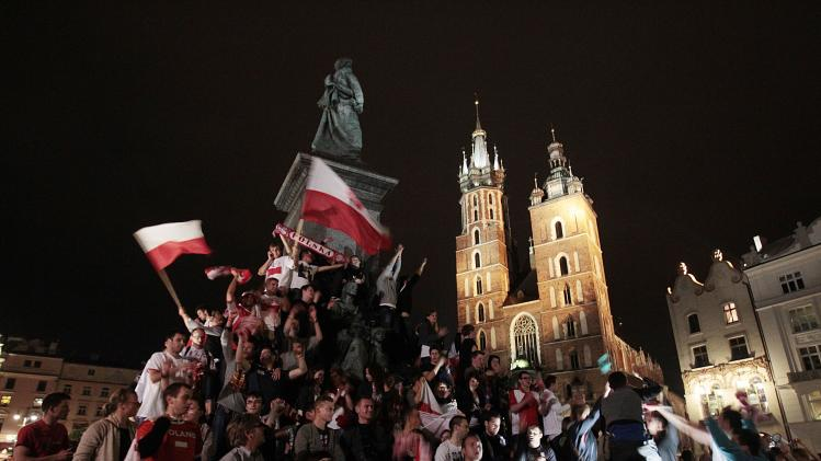 Polish fans celebrate at the end of the Euro 2012 championships soccer match between Poland and Russia in Krakow, Poland,Tuesday, June 12, 2012. The match ended in a draw. (AP Photo/Gregorio Borgia)