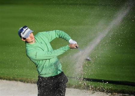 England's Justin Rose blasts his way out of the bunker on the 11th hole during first round play in the Arnold Palmer Invitational PGA golf tournament in Orlando