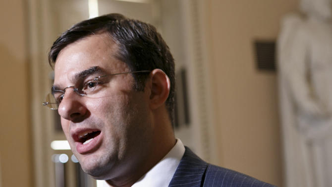FILE - In this July 24, 2013 file photo, Rep. Justin Amash, R-Mich. speaks on Capitol Hill in Washington. Hard-line House Republicans are dismissing dire warnings that a government default would wreck U.S. and world economies as another case of hyperbole from an Obama administration that cried wolf about the likely impacts of automatic spending cuts and partially shutting down the government. (AP Photo/J. Scott Applewhite, File)